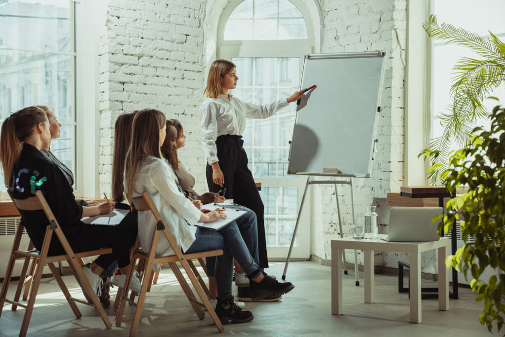 female-teacher-giving-presentation